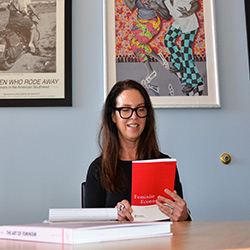 Dr. Elissa Braunstein in her office, reviewing an issue of the Feminist Economics Journal